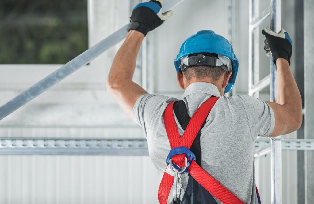 Construction Worker Climbing on Aluminium Scaffolding